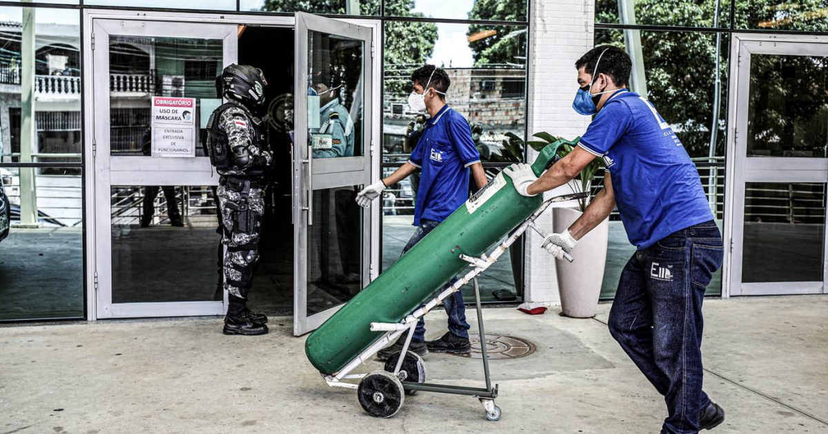 A worker arrives with an oxygen cylinder at Getulio Vargas hospital, amid the coronavirus disease (COVID-19) outbreak in Manaus, Brazil January 14, 2021.